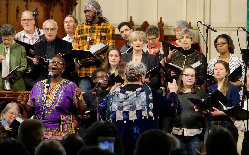 Choir members singing at concert
